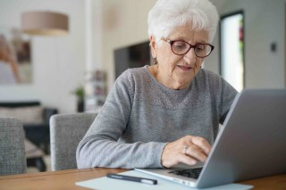 bigstock-Old-woman-at-home-using-laptop-213583483