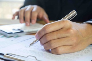 bigstock-Accountant-Working-On-Calculat-283426324