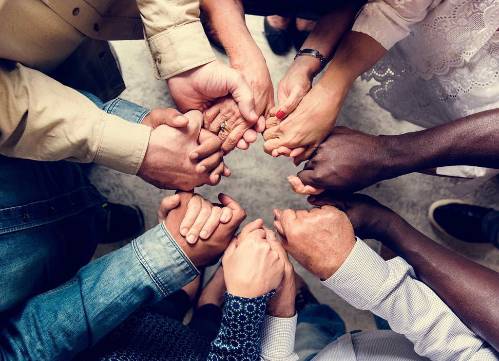 bigstock-Group-of-diverse-hands-holding-237396289
