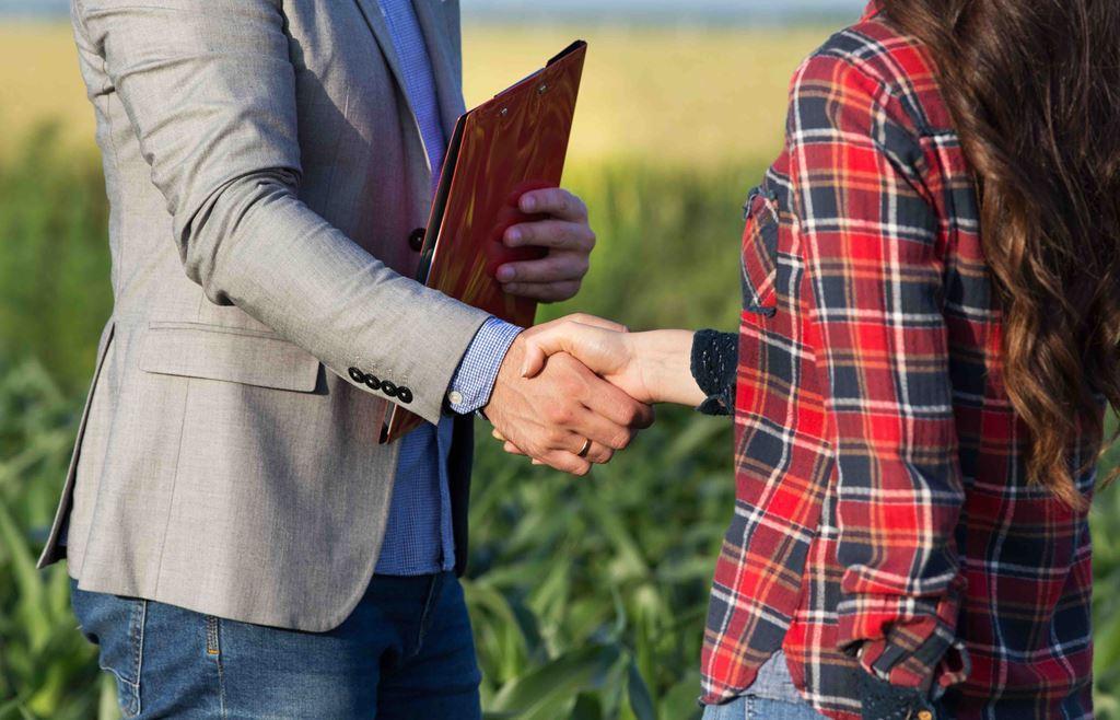 bigstock-Farmer-Woman-Shaking-Hands-Wit-305981401