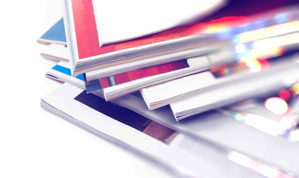 bigstock-Close-Up-Image-Of-Magazines-St-242971978