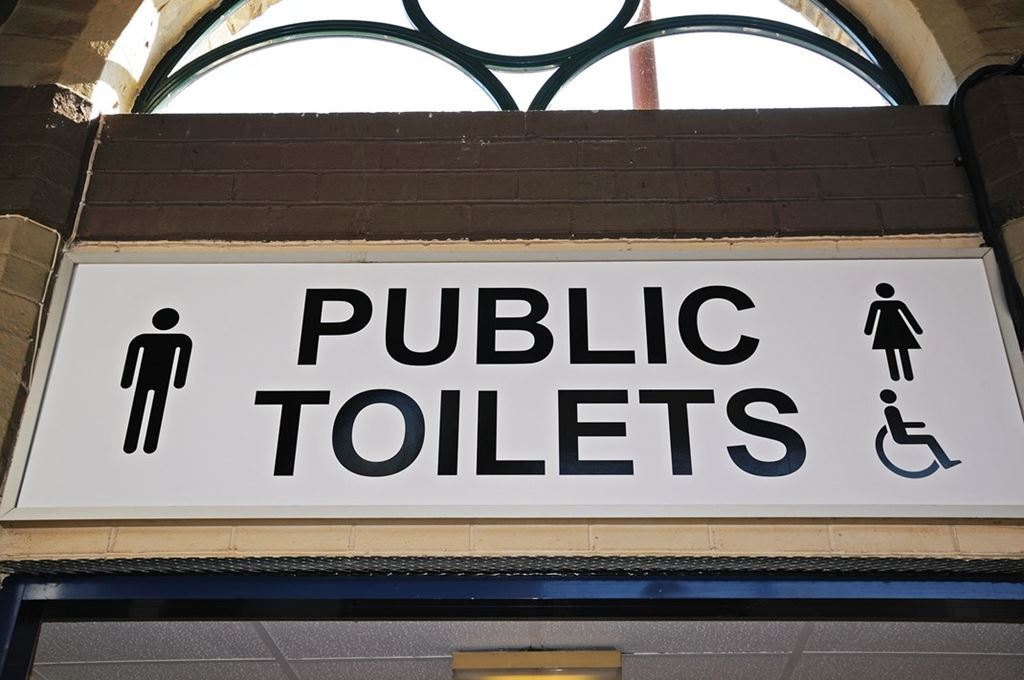 bigstock-Public-toilets-sign--85644947