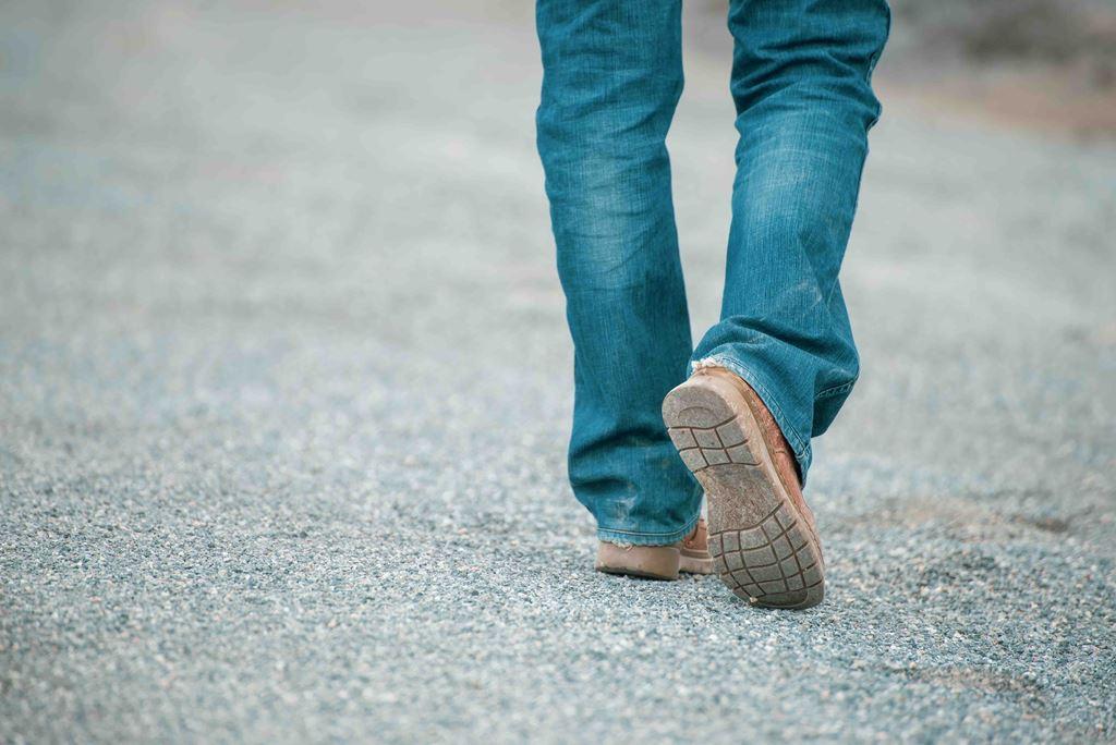 bigstock-Feet-Walking-Of-Lonely-Man-ste-309377842