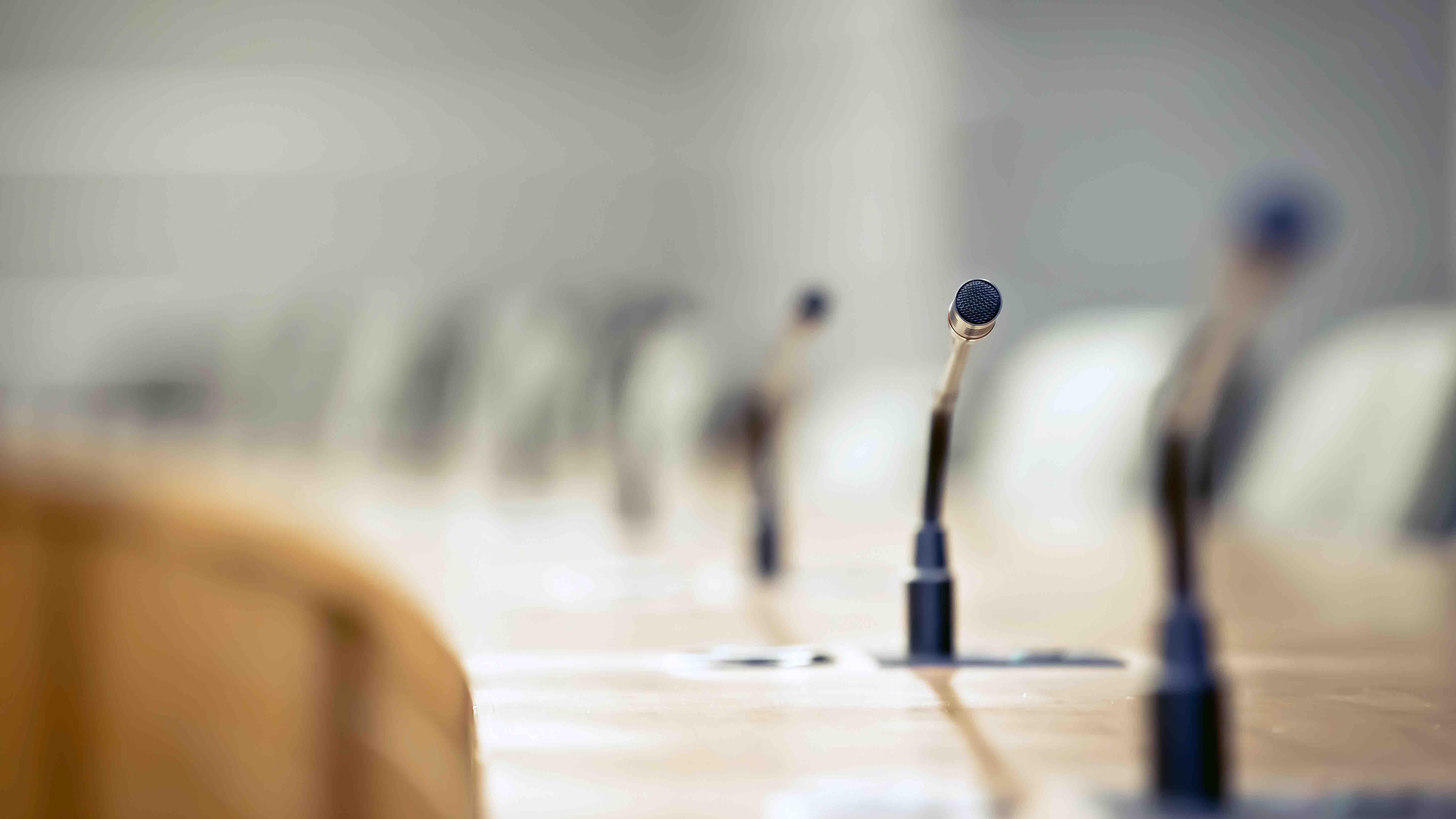 bigstock-Closeup-Conference-Microphones-382000550